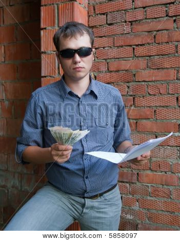 Foreman With Documents And Money