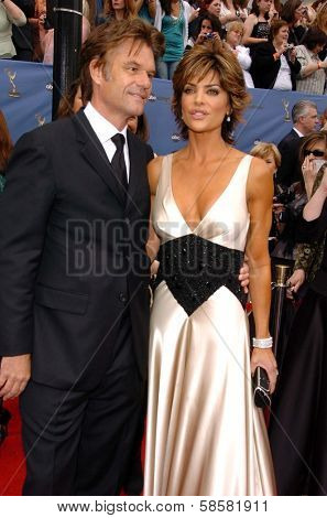 HOLLYWOOD - APRIL 28: Harry Hamlin and Lisa Rinna at The 33rd Annual Daytime Emmy Awards at Kodak Theatre on April 28, 2006 in Hollywood, CA.