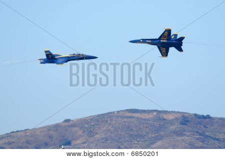 Blue Angels fly at each other