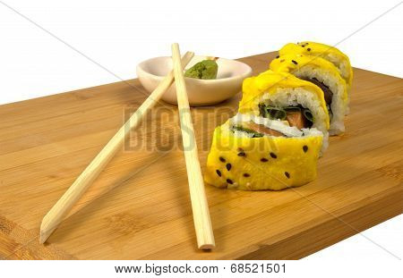 Sushi with tuna and scrambled eggs
