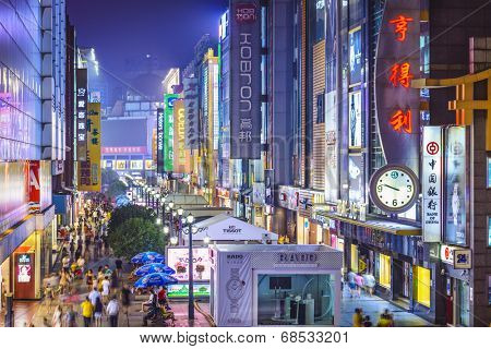 CHENGDU, CHINA - JUNE 2, 2014: Chunxi Street at night. With a history of 85 years, Chunxilu is the most famous commercial pedestrian street in Chengdu.