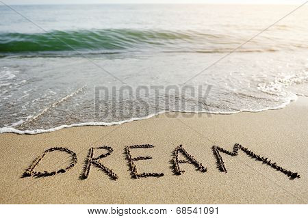 Dream Word Written On Beach Sand - Positive Thinking Concept