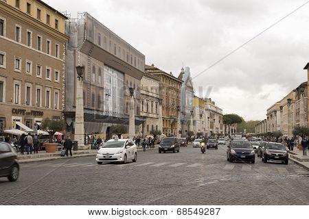 Pedestrians And Vehicles Move Along The Via Della Conciliazione (road Of The Conciliation)