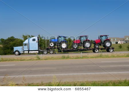Lorry truck transport with  agriculture tractor