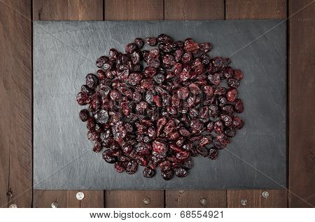 Dry Red Cranberries On A Slate Plate