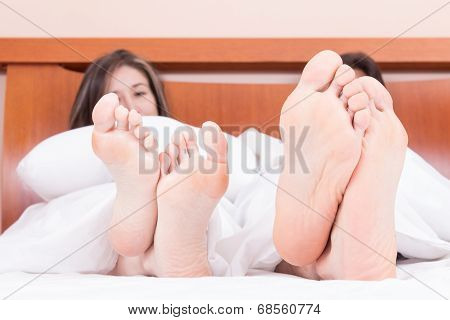 cute couple lying in bed sleeping