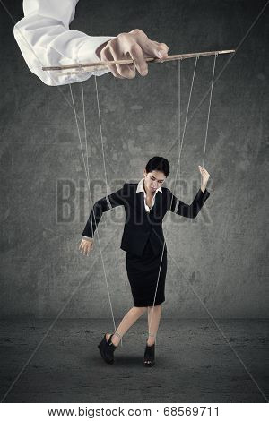 Businesswoman Hanging On String
