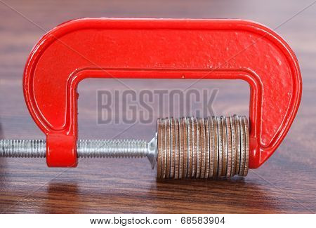 Pile Of Coins In Clamp