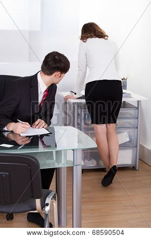 Pervert Businessman Looking At Businesswoman