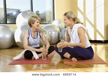 Women Sitting And Socializing At Gym