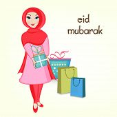 Religious Muslim girl holding gift boxes and shopping bags for Muslim community festival Eid Mubarak celebrations.  poster