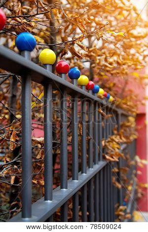 Autumn Scene With Iron Fence