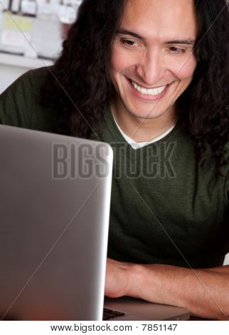 Smiling Native American Man Working On A Laptop
