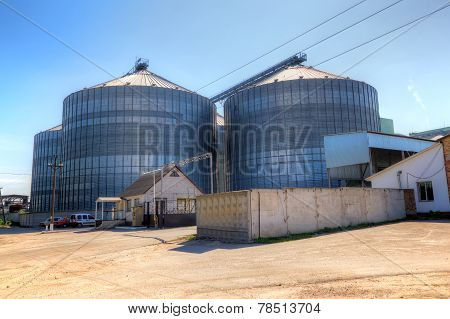 Modern grain elevator - group of metal silos poster