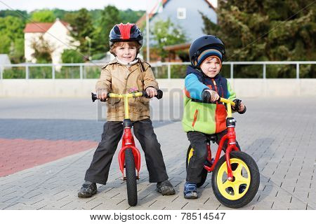 Two Little Siblings Having Fun On Bikes In City On Vacations