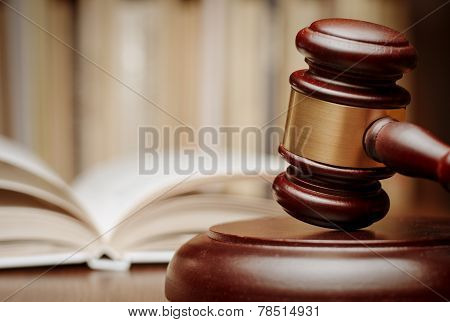 Wooden Gavel In Front Of An Open Law Book