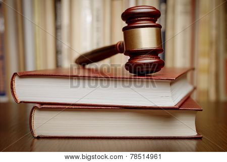 Wooden Gavel Resting On Two Large Books