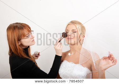 beautiful wedding bridal make-up is being applyed
