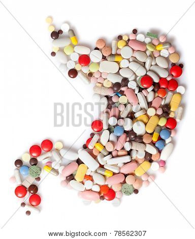 Colored pills, tablets and capsules on a white background in the form of a stomach poster