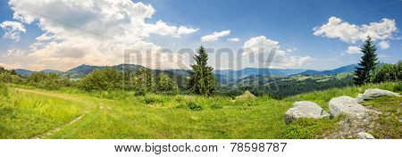 Boulders On Hillside Meadow In Mountain