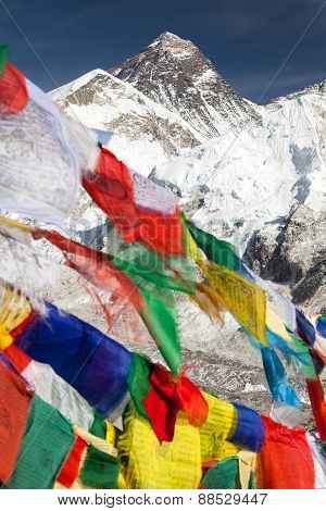 view of Mount Everest with buddhist prayer flags from Kala Patthar way to Everest base camp Nepal poster