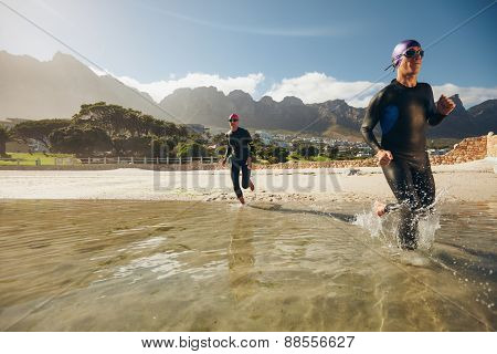 Triathlon Participants Running In The Water