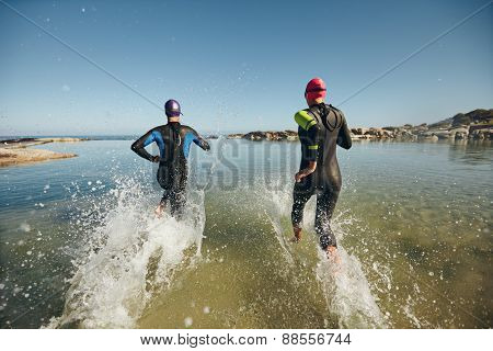 Two Athletes Competing In A Triathlon