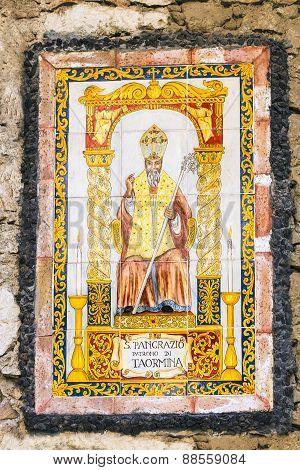 icon of Saint Pancras or Pancratius (San Pancrazio) of Taormita - patron Saint of Taormina town on the urban house wall Sicily Italy poster