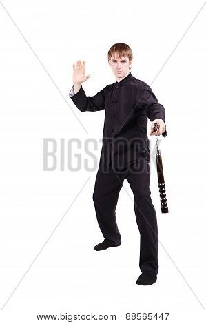 The man in a kimono practicing kung fu. Master holding nunchuck. Fighter isolated on white background. Concept of healthy life and martial arts. poster