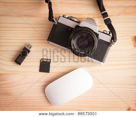 Retro Vintage Old Photo Camera With Pendrive, Sd Card And Mouse On A Wooden Table