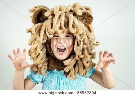 Little girl with lion mane costume roaring poster