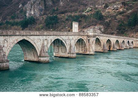 Old bridge in Visegrad on Drina river