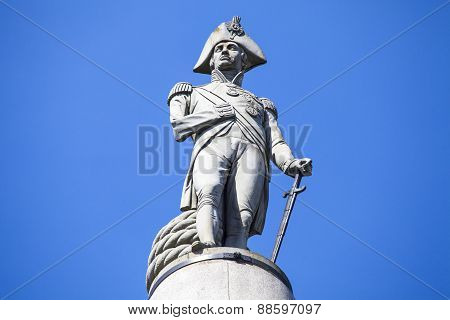 Admiral Horatio Nelson sitting proudly ontop of Nelsons Column in Trafalgar Square London. poster