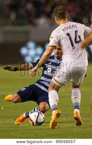 CARSON, CA. - APR 18: Benny Feilharber & Robbie Rogers in action during the L.A. Galaxy game against Sporting Kansas City on April 18, 2015 at the StubHub Center in Carson, California.