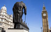 A statue of arguably Britain's most iconic Prime Minister Sir Winston Churchill located on Parliament Square in London. poster