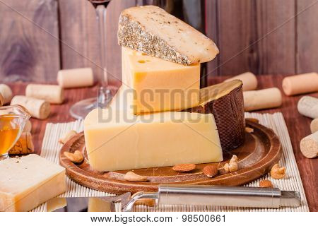 Assorted Cheese Plate With Red Wine, Nuts And Honey
