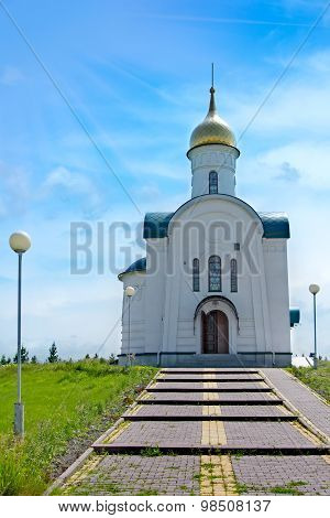 View Of Rural Small Orthodox Chapel With Golden Dome