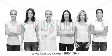 healthcare and medicine concept - group of smiling women and doctor in blank t-shirts with pink breast cancer awareness ribbons