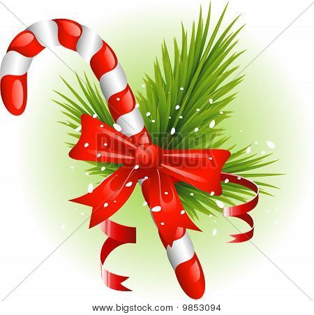 Christmas candy cane decorated with pine branches and a bow