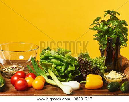 Fresh Salad Ingredients And Yellow Background