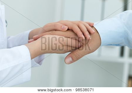Female Medicine Doctor Reassuring Her Patient