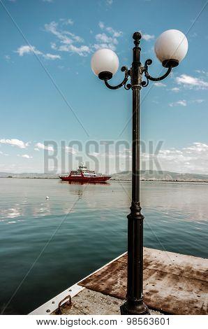 Mediterranean Ferryboat Harbor With Citylight