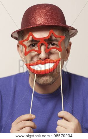Cheerful man in a mask and a red hat