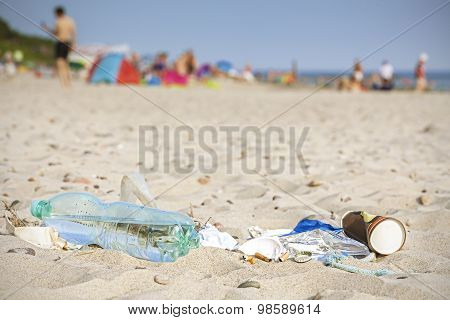 Garbage On Beach Left By Tourist, Environmental Pollution Concept.