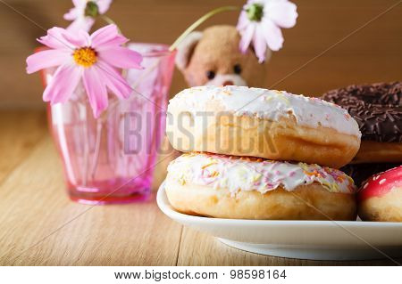 Delicious Donuts On Wood Table With Toy