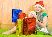new year girl with two pet rabbits sitting in home poster