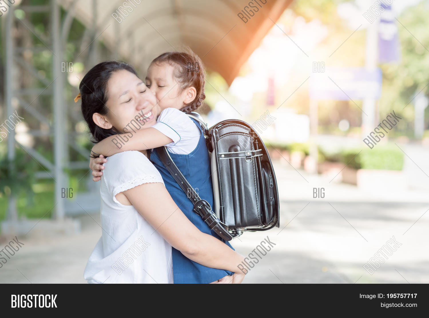 mother hug kiss cute girl student image & photo | bigstock