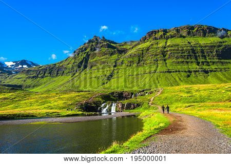 Wonderful Waterfal Kirkjufellsfoss In Iceland In Autumn Colors