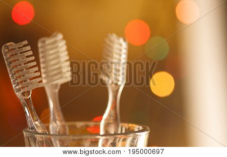 Toothbrushes on colorful blurry background with lightning.
