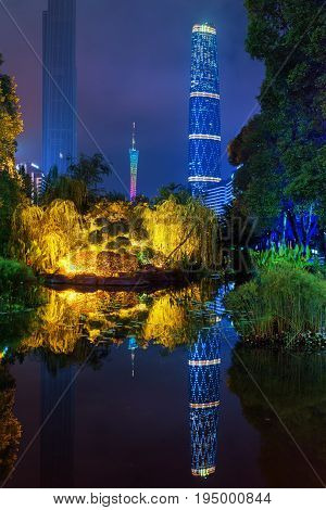 The Canton Tower Reflected In Pond, Guangzhou, China